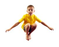 Child exercising and jumping Stock Image