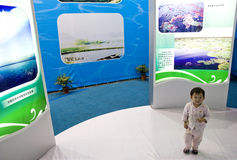 Child in exhibition. A child is looking around in the China International Lake Management and Technology & Equipment Exhibition which is hold in Wuhan China.The Stock Photo