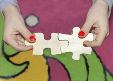 The child experienced success to put on a puzzle stock photo