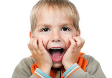 Child expressing surprise. With his hands in his face isolated on white background Royalty Free Stock Image