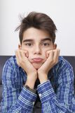 Child with an expression of boredom or tiredness. Child, teenager or preteen with an expression of boredom or tiredness royalty free stock photo