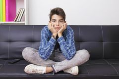 Child with an expression of boredom or tiredness. Child, teenager or preteen with an expression of boredom or tiredness stock image
