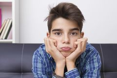 Child with an expression of boredom or tiredness. Child, teenager or preteen with an expression of boredom or tiredness stock photos