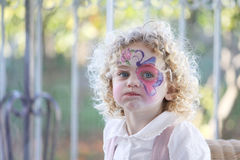 Child expressive portrait. Portrait of an expressive young caucasian child with her face painted Royalty Free Stock Image