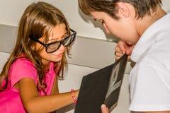 Child eye exam. Littlie girl is taking the eye exam test at optometrist office stock images