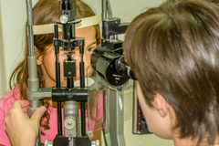 Child eye exam. Littlie girl is taking the eye exam test at optometrist office Royalty Free Stock Photo