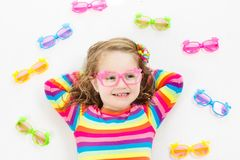 Child at eye sight test. Kid at optitian. Eyewear for kids. Child at eye sight test. Little kid selecting glasses at optician store. Eyesight measurement for Stock Image