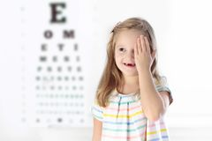 Child at eye sight test. Kid at optitian. Eyewear for kids. Child at eye sight test. Little kid selecting glasses at optician store. Eyesight measurement for Stock Photography