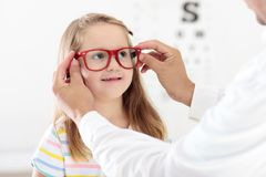 Child at eye sight test. Kid at optitian. Eyewear for kids. Stock Photo
