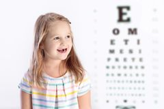 Child at eye sight test. Kid at optitian. Eyewear for kids. Child at eye sight test. Little kid selecting glasses at optician store. Eyesight measurement for Royalty Free Stock Photos