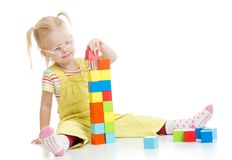 Child in eyeglases playing building blocks Royalty Free Stock Image