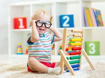 Child with eyeglasses playing abacus Royalty Free Stock Images