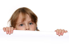 Child eyes. Child looking over white panel Royalty Free Stock Images