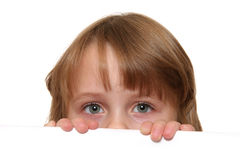 Child eyes. Child looking over white panel Royalty Free Stock Photography