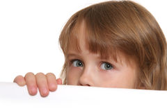 Child eyes. Child looking over white panel Stock Photography