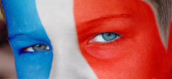 Child face with a painted french flag Stock Photos