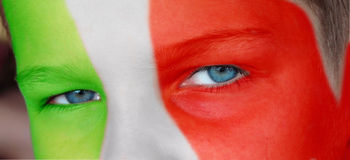 Child face with a painted italian flag. Close up on a child face with a painted italian flag Royalty Free Stock Photos