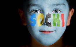Child face with painted text Sochi Stock Image