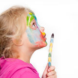 Child face painting. Little girl making face painting royalty free stock photography