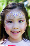 Child Face Painting. Little girl had her face painted at the fair Royalty Free Stock Images