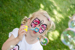 Child with face painting. Blond girl with face painting royalty free stock image