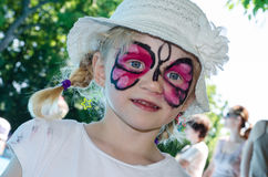 Child with face painting. Blond girl with face painting stock photos