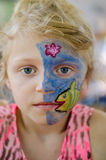 Child with face painting. Blond girl with face painting stock images