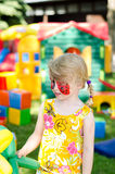 Child with face painting. Blond girl with face painting royalty free stock photos