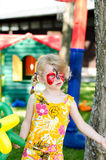 Child with face painting. Blond girl with face painting royalty free stock photo