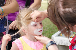 Child with face painting Royalty Free Stock Photos