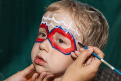 Child with face painting Royalty Free Stock Images