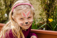 Child with face painting. Little girl with rabbit face painting stock images