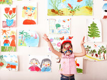 Child with face painting in play room. Preschooler stock photography