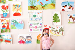 Child with  face painting in play room. Stock Photo