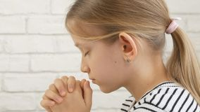 Child Face Praying Before Eating, Kid in Kitchen, Girl Portrait Meditating stock photography