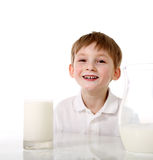 Child with face soiled milk Stock Photography
