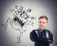 Child faces a virus. Pissed child faces an ugly monstrous virus Stock Images