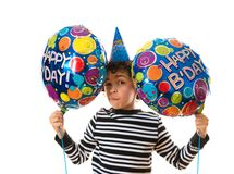 Child with a facial expression during his birthday Royalty Free Stock Photo