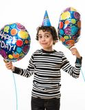 Child Facial Expression During His Birthday Party. Holding Balloons and over a white background Royalty Free Stock Images