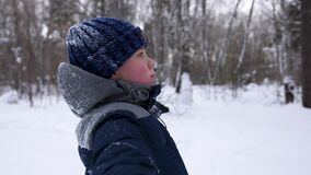 A child fall in the snow in slowmotion. Snow storm. Sports outdoors. Active lifestyle. stock video footage