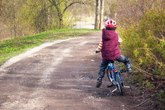 Child falling from a bike Stock Image