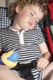 Child falls asleep sitting up Royalty Free Stock Image