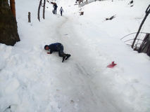 Child falls down but still feels happy stock photos