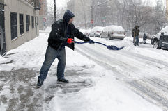 Child falls during snow storm in New York Stock Image