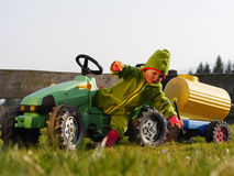 Child falls from a tractor. Child is playing with a tractor Stock Photos