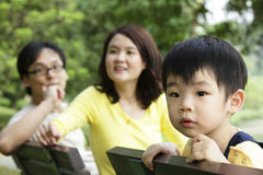 Child with family stock photo