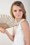 Child with a fan Royalty Free Stock Image