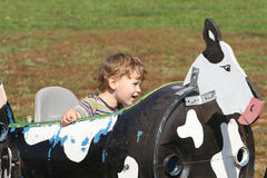 Child on a farm ride hayride Stock Photography