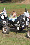 Child on a farm ride hayride Royalty Free Stock Photography