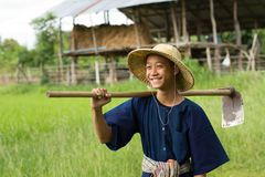 Happy asia children of farmer working in the farm. Child of farmer help his family holding a hoe with smiling and happy face, Lifestyle of asia farmer, and our royalty free stock photos